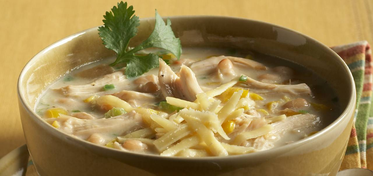 White chicken chili with kerrygold aged cheddar cheese hero