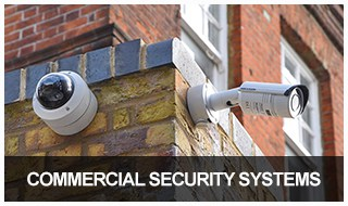 image of two outdoor CCTV cameras mounted on the side of a brick building