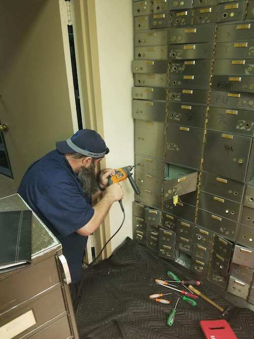 safe locksmith drilling a safe in Chicago IL bank.