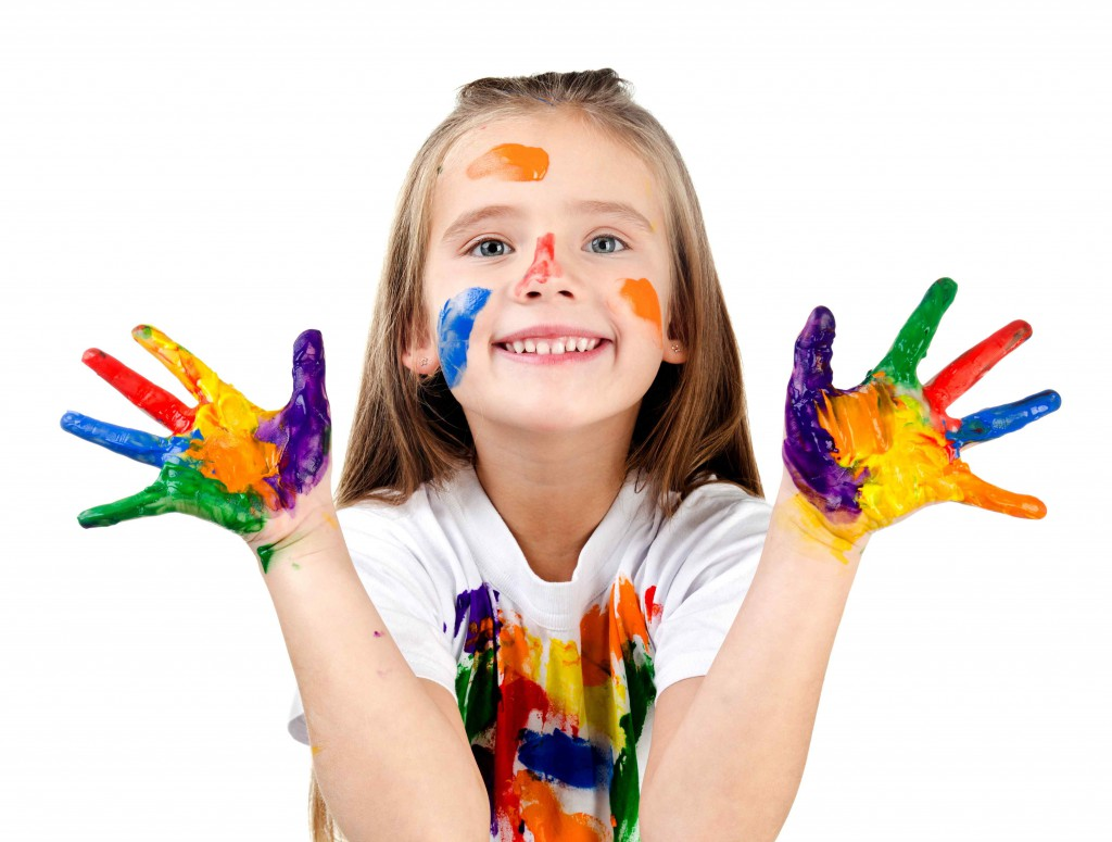 happy cute little girl with colorful painted hands - Colour Kid