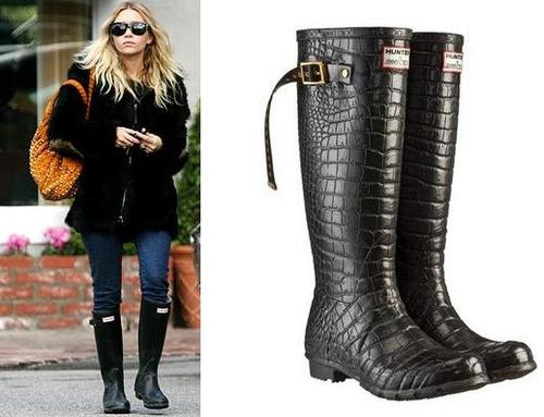 Ashley Olsen in chic black rain boots