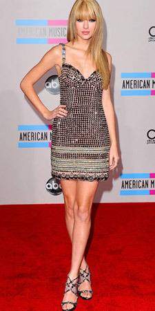 Taylor Swift goes for straight hair and silver sequins!