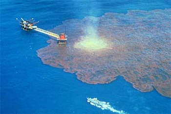 A leaking oil tanker causes an oil spill in the ocean