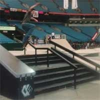 Skateboarders launches down a set of stairs at 2004 Slam City Jam.