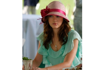 Blair beats the heat with this raspberry sisal hat from Louise Green