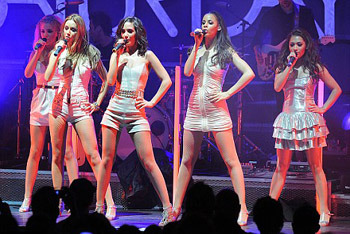 Performing onstage in all silver