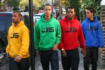 JLS sporting matching sweatshirts!