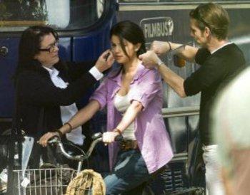 Selena gets make up done before shooting a scene