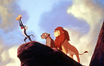 Mufasa and the Queen look as the wise Rafiki presents their son Simba to the heavens