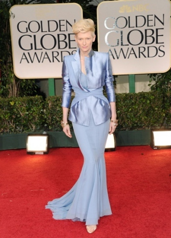 Odd but interesting, actress Tilda Swinton pulls off a tux and a dress!