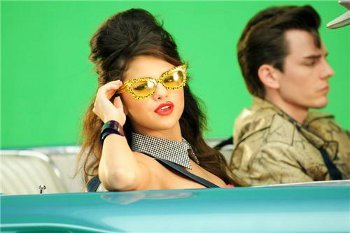 """In """"Love You Like A Love Song"""" Selena Takes a Karaoke trip through the ages"""