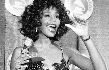 Whitney winning Best Pop Vocalist at the Grammy Awards in 1988