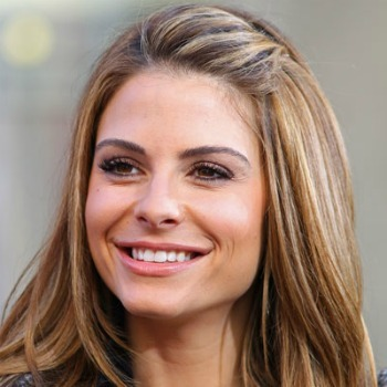 Maria Menounos pins her bangs up with a twist