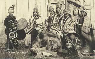 Chilkat dancers pose in ceremonial dress