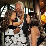 Emma (right) with Morgan Freeman