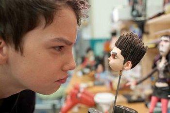 Kodi (age 14) checks out Norman's head