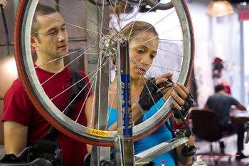 Wilee (Joseph) watches Vanessa (Dania) fix her bike