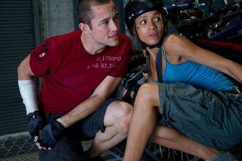 An injured Wilee (Joseph) with girfriend Vanessa (Dania Ramirez)