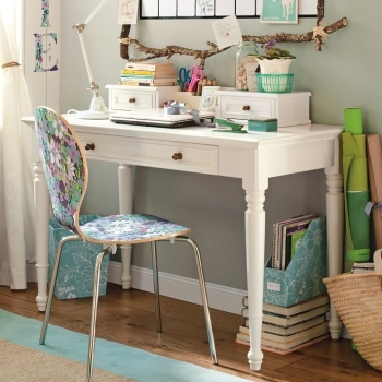 This desk may look cute, but it's too cluttered to use as a work space. Keep your desk clear.