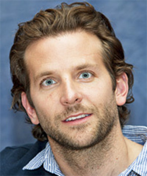 Bradley Cooper with a softly styled look created with styling creme or light hold gel to tame his curls and lock his style in place