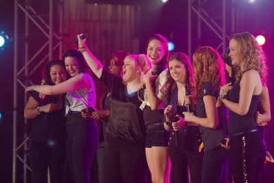 Rebel (center) sings with The Bellas