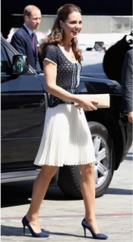 Cute and conservative in a flared knee-length white skirt and crocheted cropped sweater. Notice how her accessories coordinate with her outfit.
