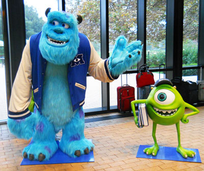 Monsters University versions of Sulley and Mike greet Pixar visitors