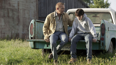 Young Clark (Dylan Sprayberry) with Jonathan Kent (Kevin Costner)