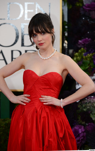 Zooey Deschanel in red with her awesome nail art, 2013 version