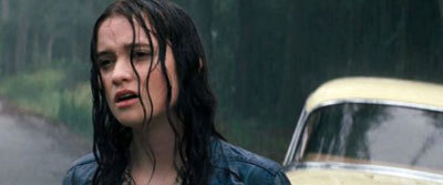 Alice as Lena in a drenched scene