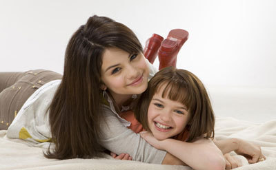 A younger Joey with Selena Gomez