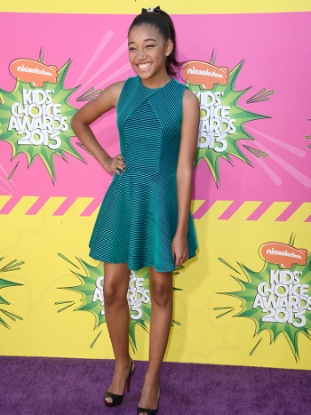 Amandla looks terrific in teal and is wearing the best accessory of all - a smile!