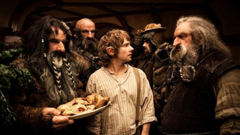 The Dwarves show up at Bilbos house as unexpected dinner guests