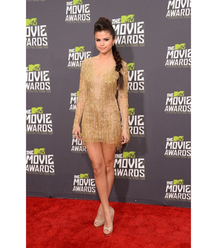Selena Gomez steals the spotlight in this short metallic gold number!