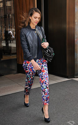 Jessica Alba works floral trousers and a biker jacket
