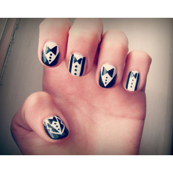 Why not try elegant black and white nails?