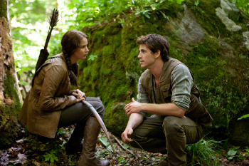 Jennifer Lawrence and Liam Hemsworth as Katniss and Gale