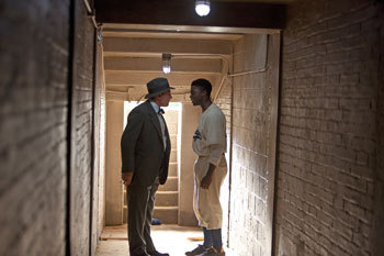 Harrison Ford ad Branch Rickey and Chadwick Boseman as Jackie Robinson