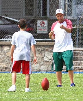 Adam teaching son Cameron to kick the football