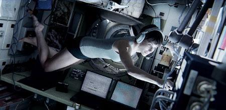 Sandra as Ryan, floats inside an air lock
