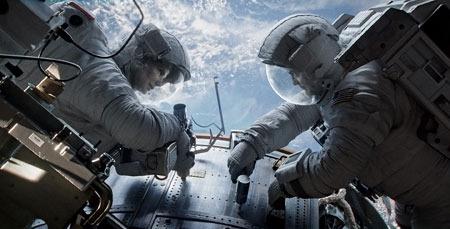 Astronauts Stone and Kowalski work on the Hubble Telescope