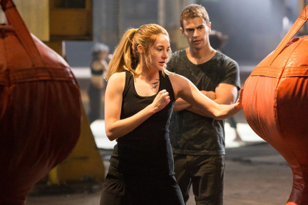 Four (Theo James) watching as Tris (Shailene Woodley) trains