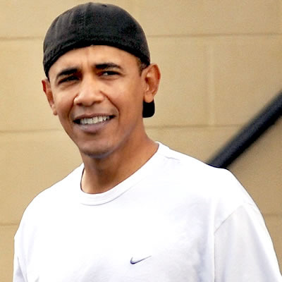 President Obama wearing a baseball hat