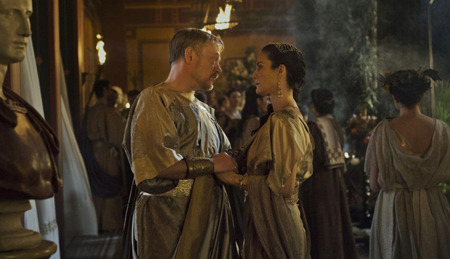 Cassia's parents (Jared Harris and Carrie-Anne Moss) discuss Corvus and Cassia