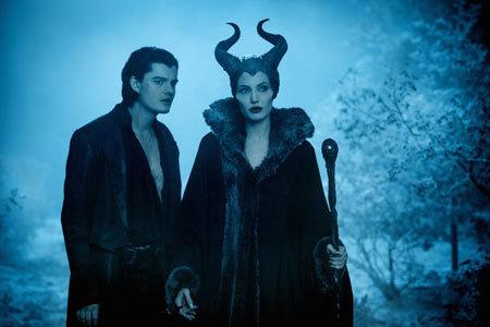 Maleficent (Angelina Jolie) with servant Diaval (Sam Riley)