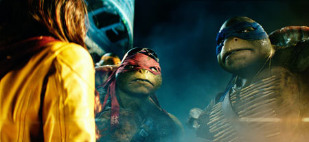 April (Megan Fox) confronted by Raphael and Leonardo