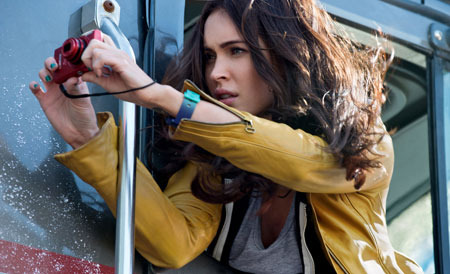 April O'Neil (Megan Fox) sneaks a shot of the Turtles