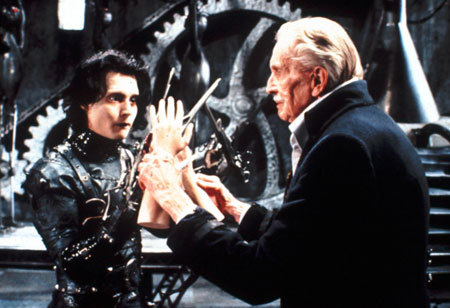 The inventor (Vincent Price) shows Edward (Johnny Depp) his new hands
