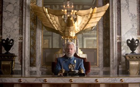 Snow (Donald Sutherland) at his desk