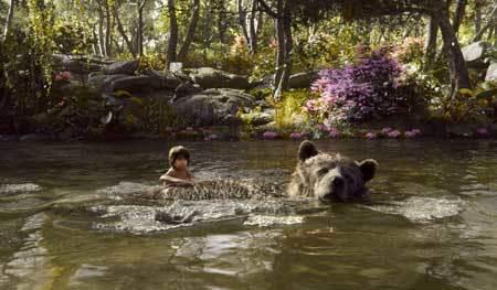 Mowgli swims with Baloo
